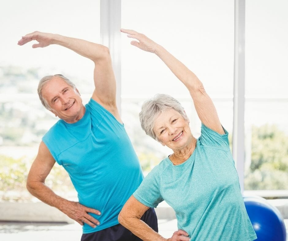 older man and woman working out
