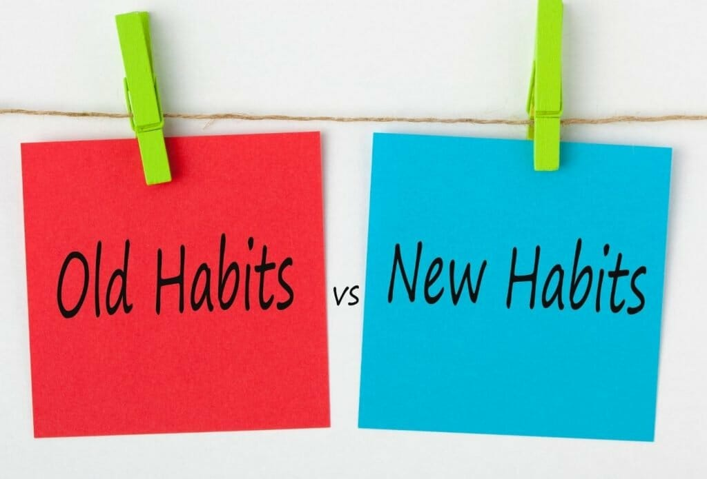 sticky notes that say old habits and new habits that are held onto a line by clothes pins