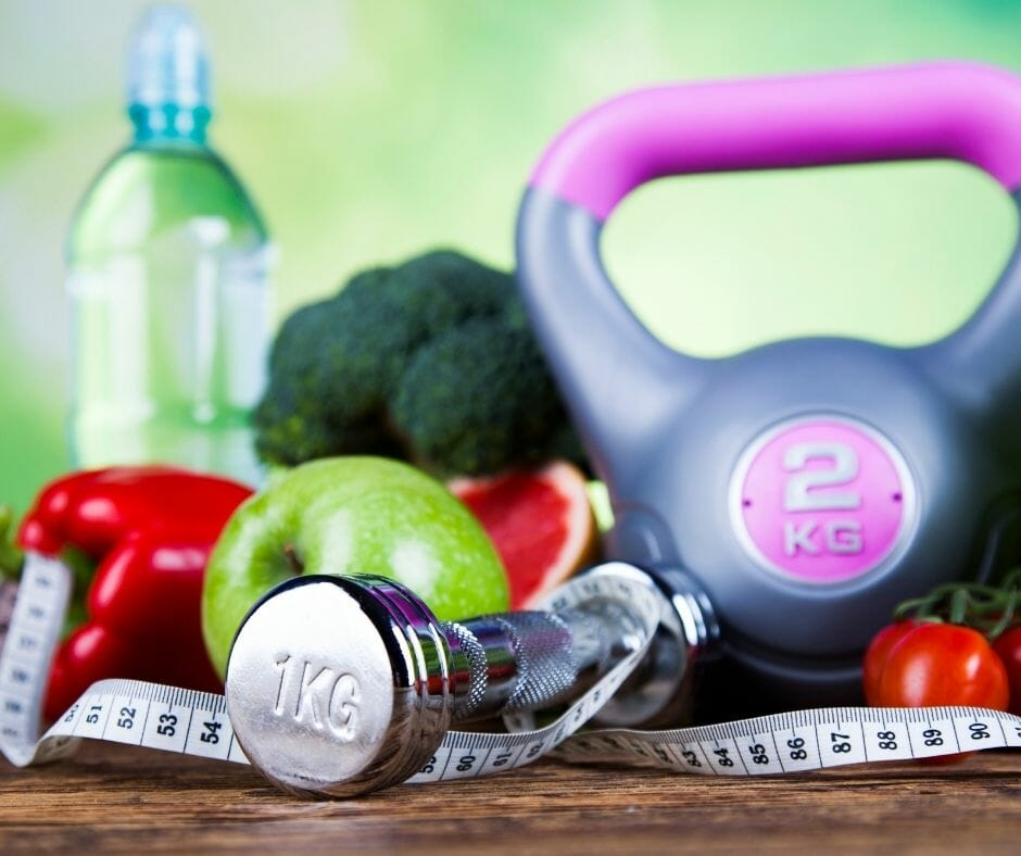 wellness items such as kettle bell, smart bell, tape measure, water and fruit