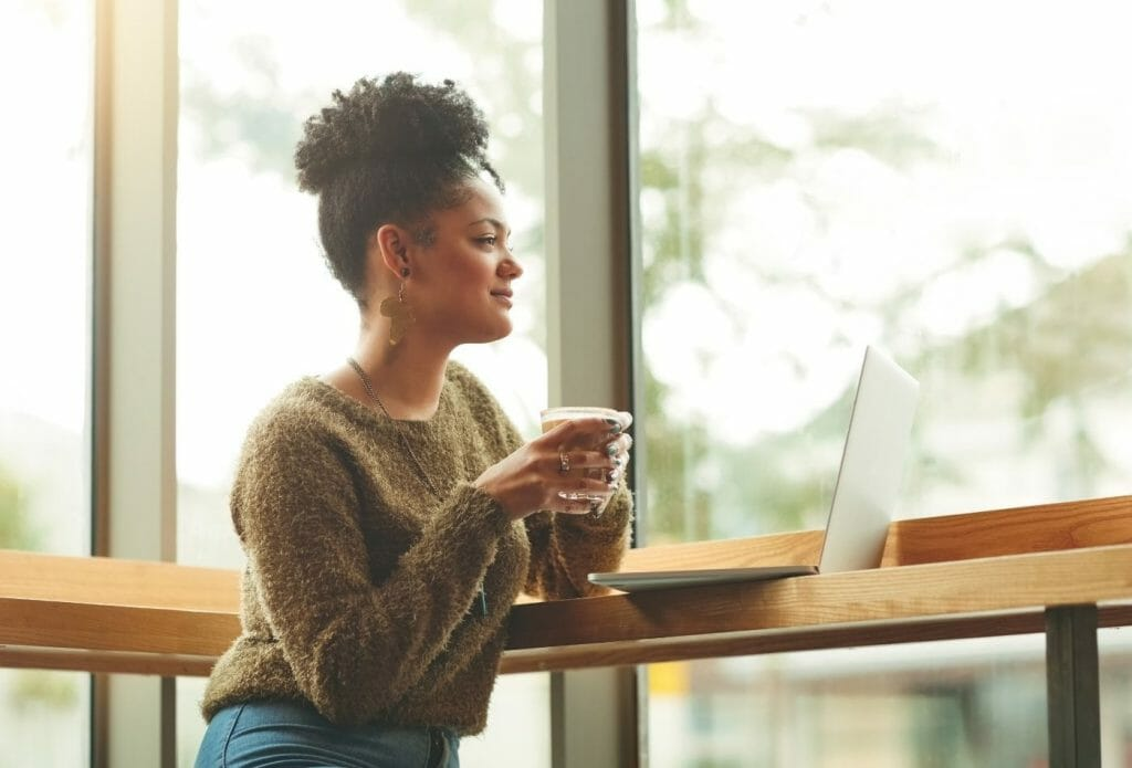 woman sitting by herself drinking coffee