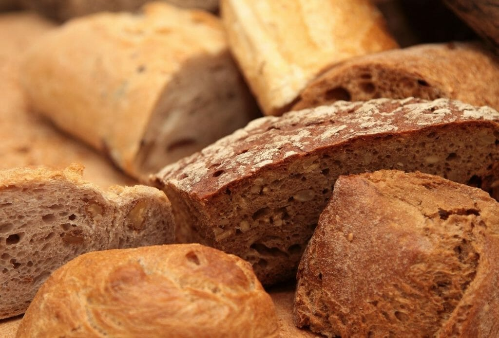 ancient grain breads arranged together on a board