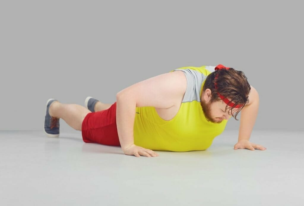 man struggling to do push up