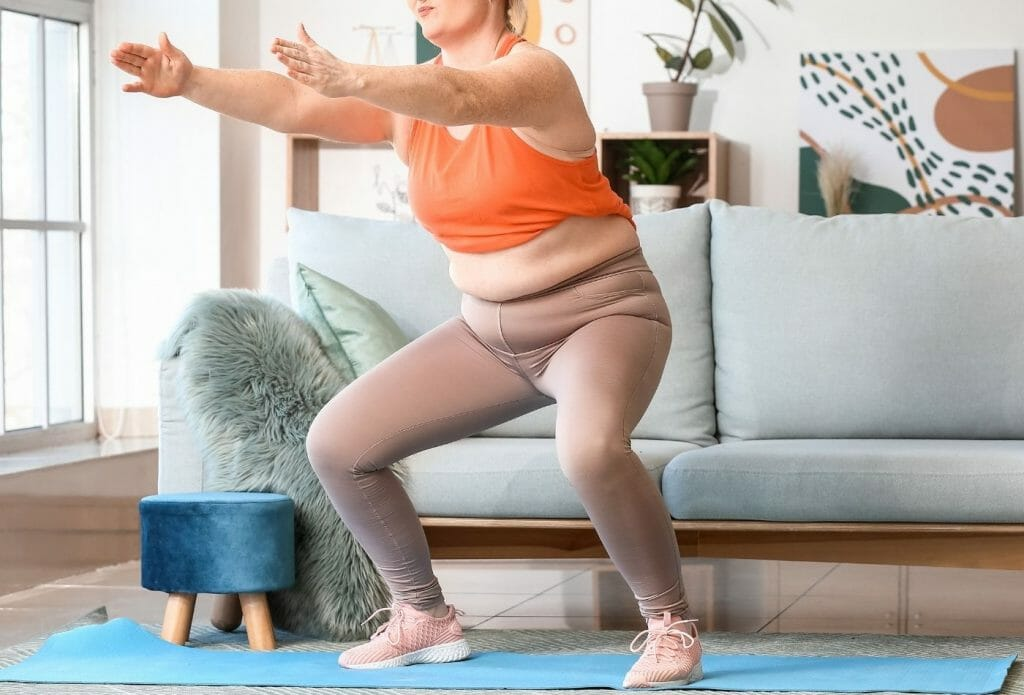 Obese woman doing bodyweight chair squats