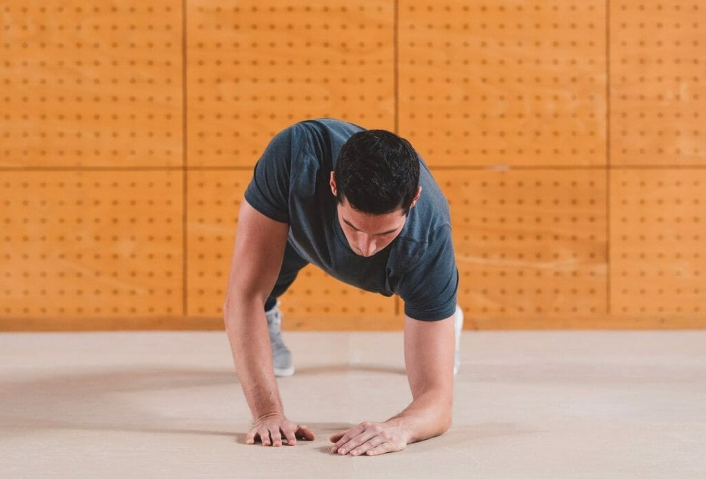 man doing up down plank