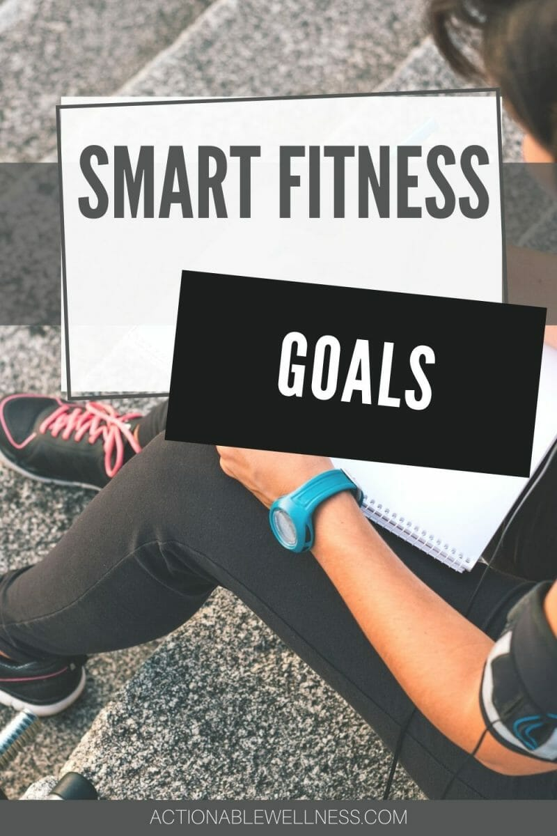 woman sitting on steps writing her fitness goals