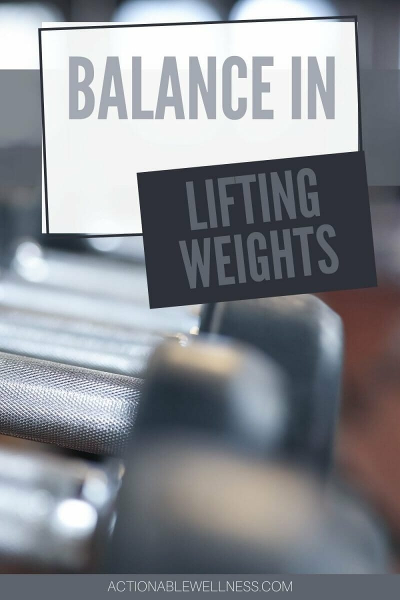 weights lined up on a rack to show balance in lifting weights